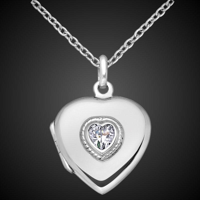 Relicario corazón de plata con una piedra