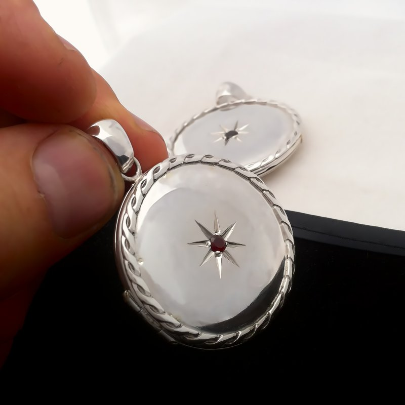 Round locket photo pendant with a Garnet stone in the center sterling silver